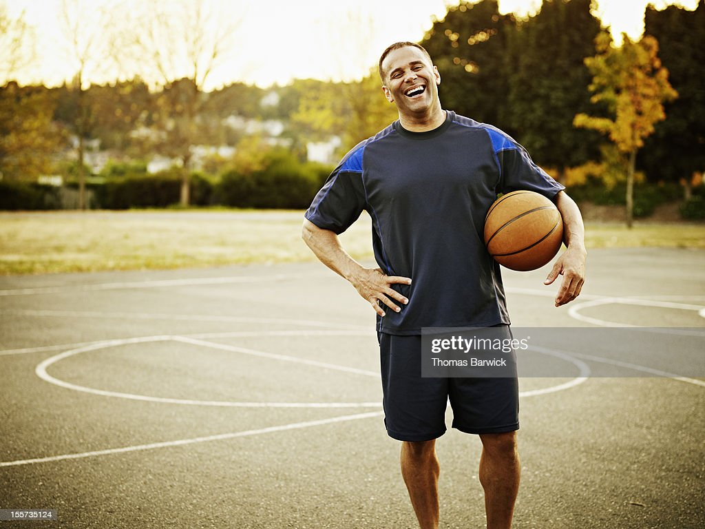 Mature basketball player standing on outdoor court