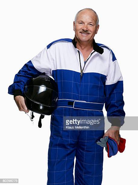 Mature biker holding crash helmet, smiling, portrait