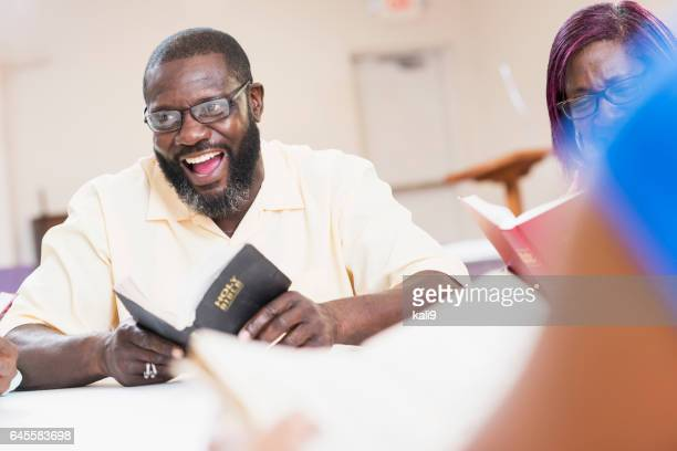 Mature black man speaking in bible study meeting