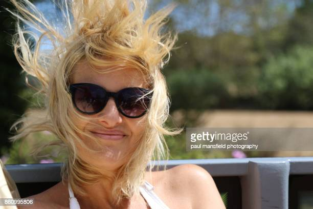 Mature blond lady with windswept hair