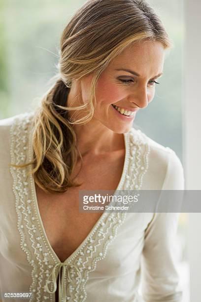 Mature blonde woman looking down, portrait