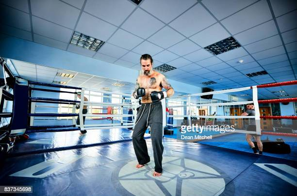 Mature boxer warming up in boxing ring