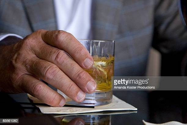 mature business mans hands with coctail