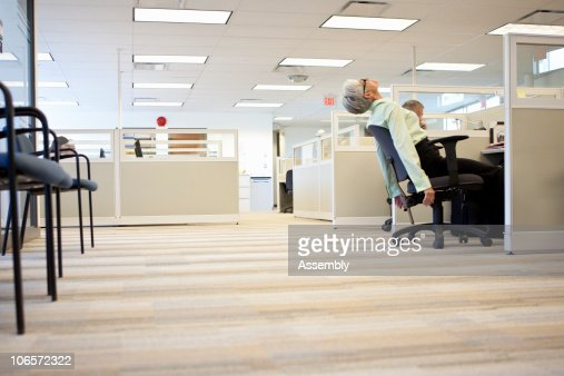 mature business woman leans back in chair