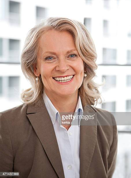 Mature business woman smiling
