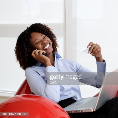 Mature business woman talking on mobile, laughing : Stock Photo