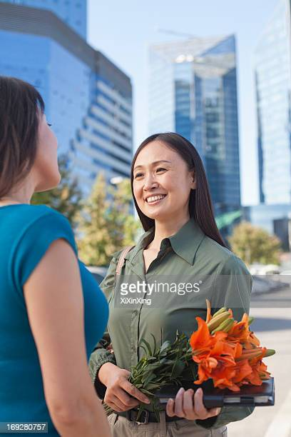 Mature Business Woman With Flowers