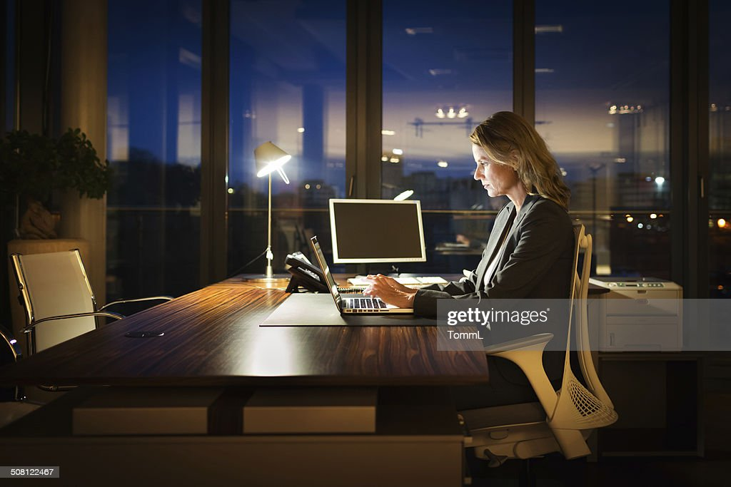 Mature Business Woman Working Late