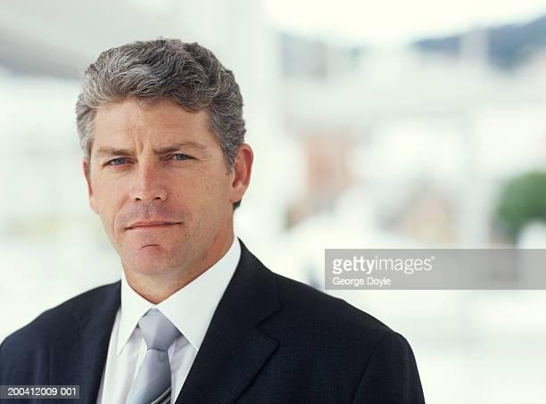 Mature businessman, close up, portrait