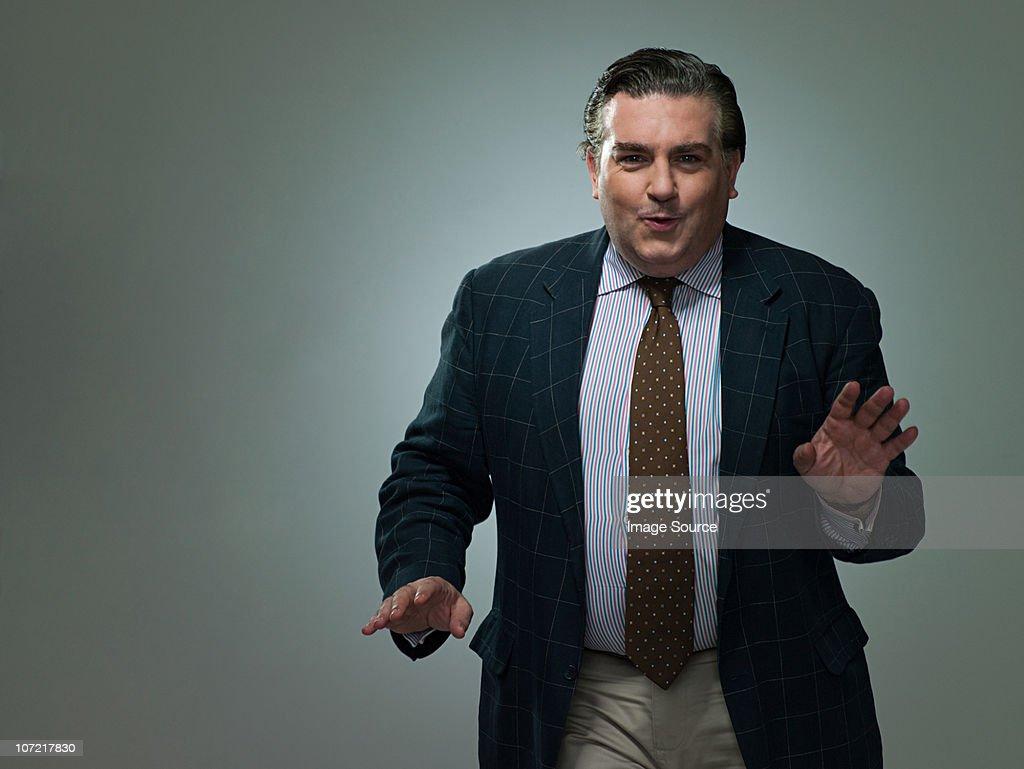 Mature businessman dancing, portrait : Stock Photo