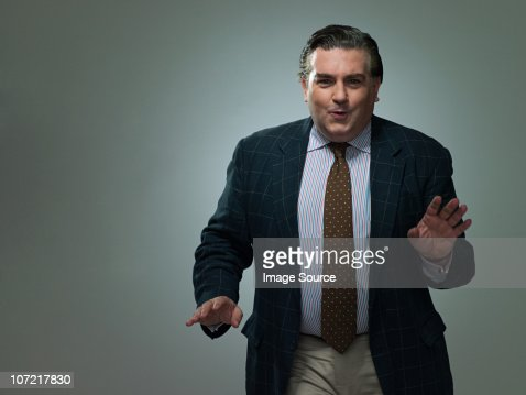 Mature businessman dancing, portrait : Stock Photo