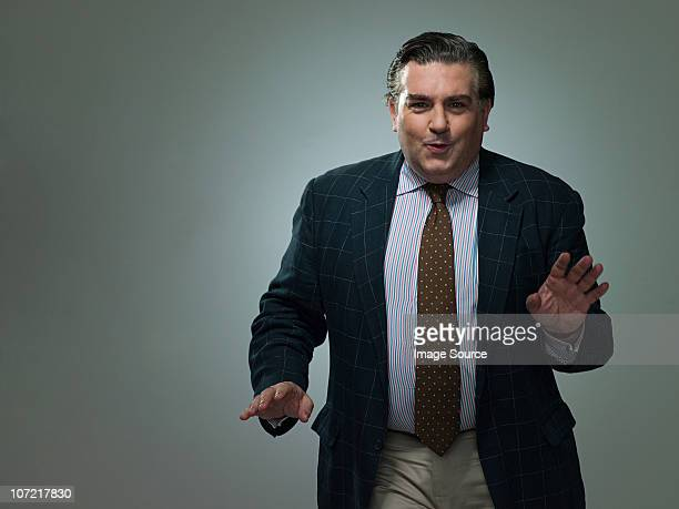 Mature businessman dancing, portrait