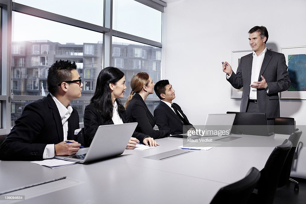 Mature businessman explaining at a meeting : Stock Photo