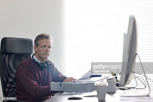 Mature businessman going through documents