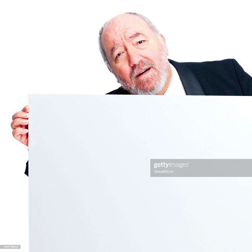 Mature businessman holding white board : Stock Photo