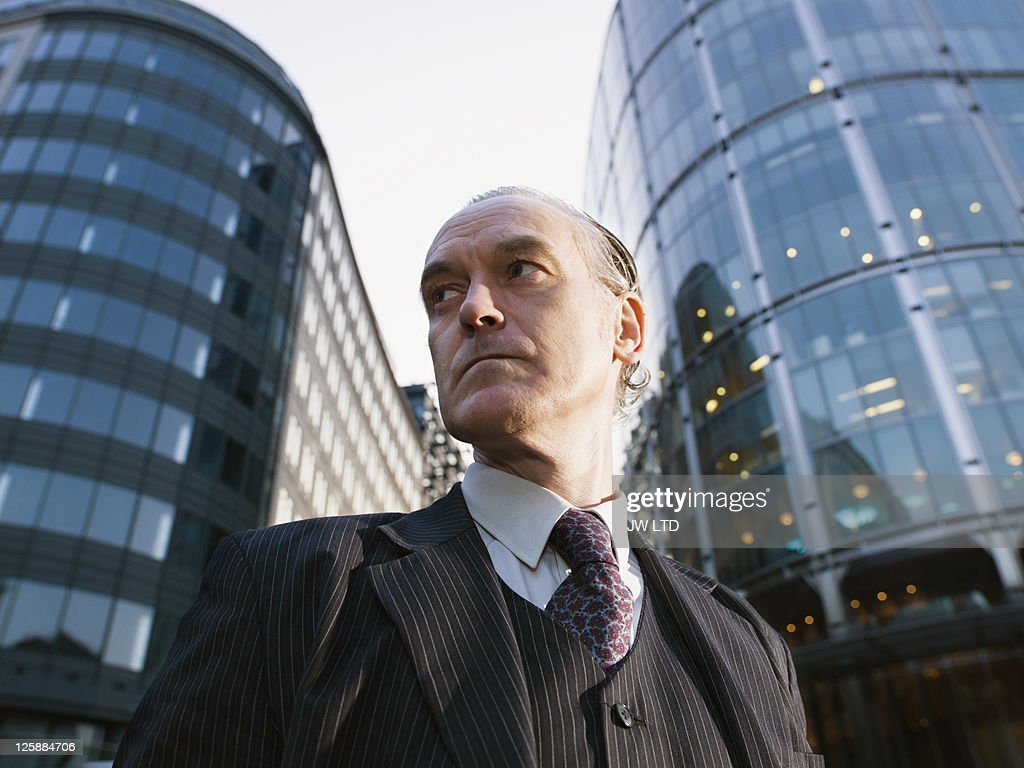 Mature businessman in city, low angle