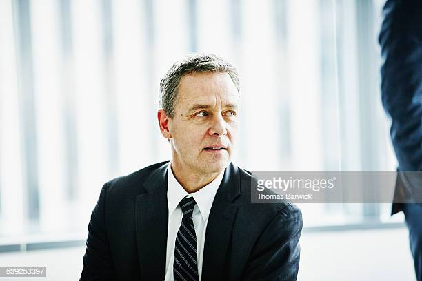 Mature businessman in discussion in office