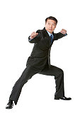 Mature businessman in martial arts fighting stance
