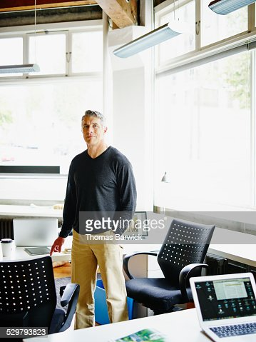 Mature businessman in small startup office