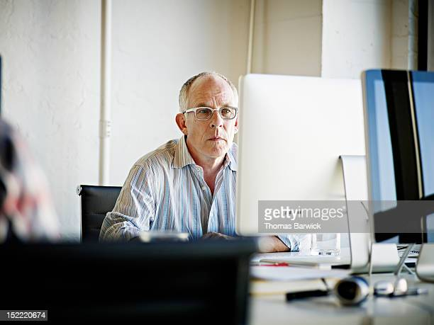 Mature businessman looking at computer monitor