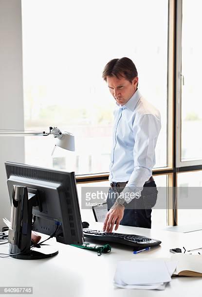 Mature businessman looking at computer screen