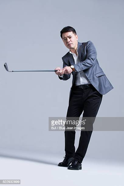 Mature businessman playing golf