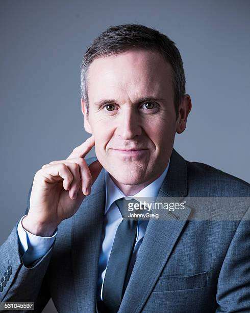 Mature businessman portrait on grey