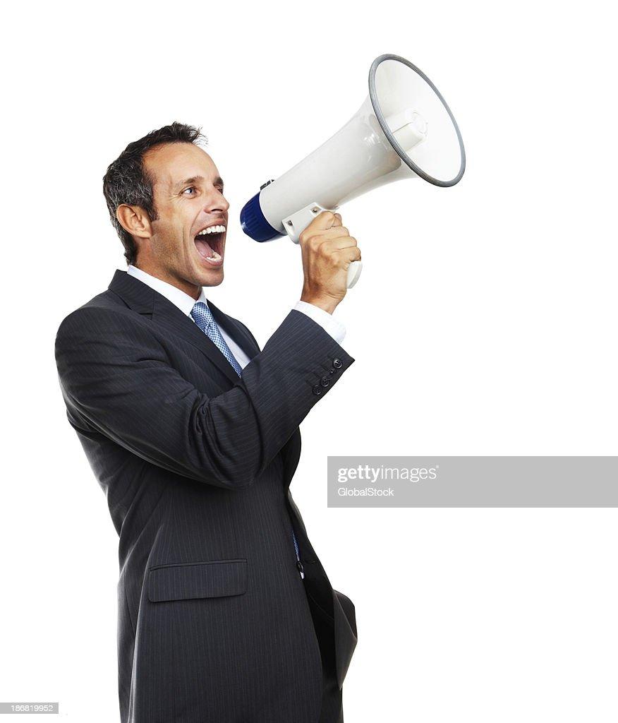 Mature businessman screaming into megaphone