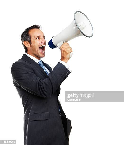 Mature businessman screaming into megaphone
