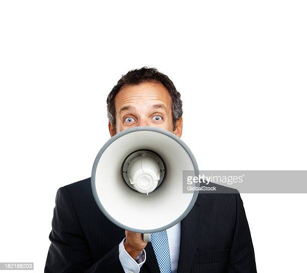 Mature businessman shouting into a megaphone