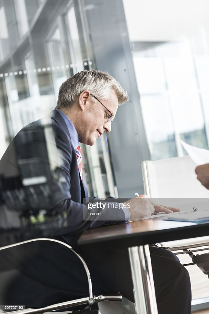 Mature Businessman Signing Contract