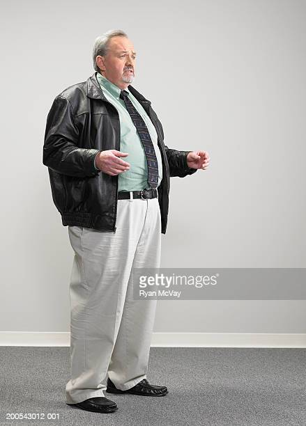 Mature businessman singing, looking away