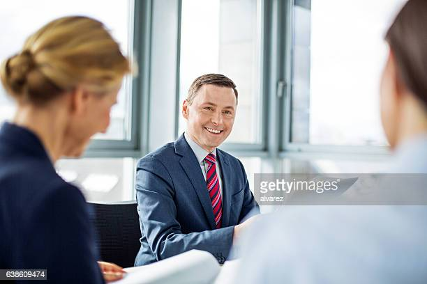 Mature businessman sitting in a meeting with colleague