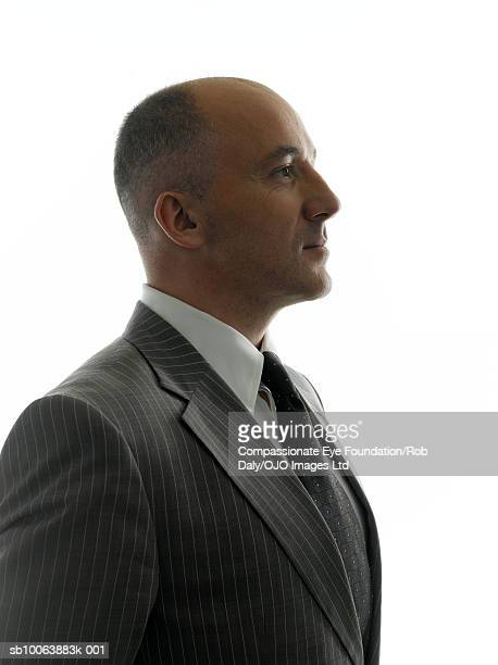 Mature businessman, smiling, side view