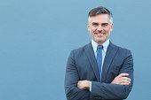 Mature businessman smiling wearing classic suit.