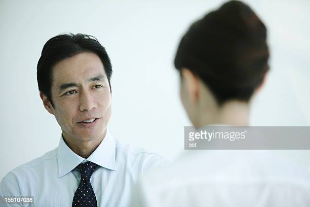 Mature businessman talking in office,close up