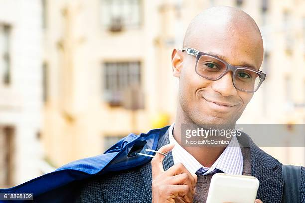 Mature businessman urban portrait with dry cleaning and phone