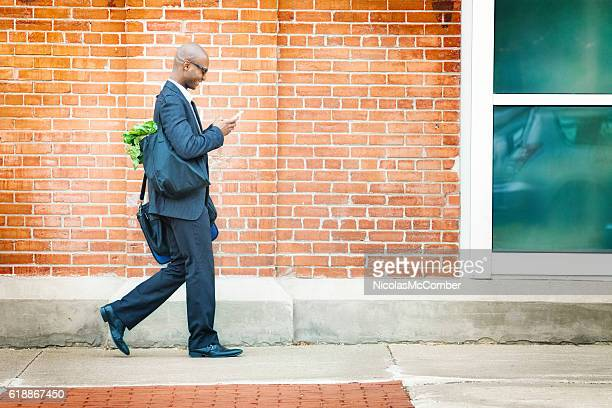 Mature businessman walking back home with groceries