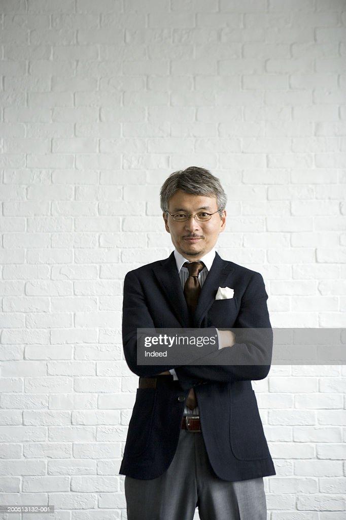 Mature businessman with arms folded, portrait