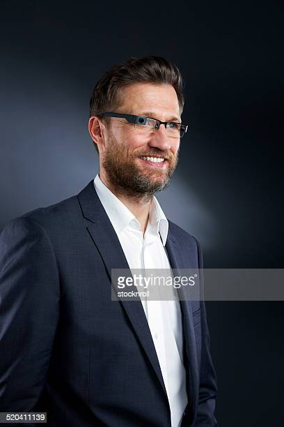 Mature businessman with smart glasses