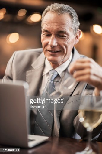 Mature businessman working on a laptop. : Stock Photo