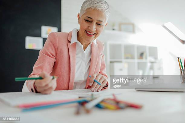 Mature Businesswoman Coloring Book In Her Office.