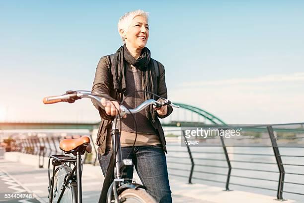 Mature Businesswoman Commuting To Work.
