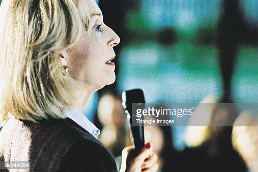 Mature Businesswoman Giving Presentation : Photo