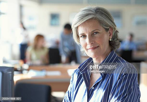 Mature businesswoman in office, portrait, close-up
