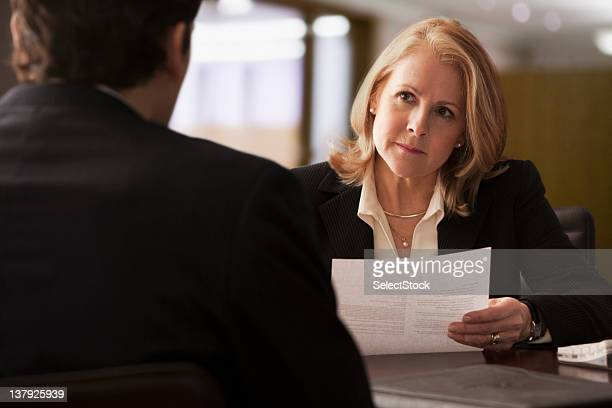 Mature businesswoman interviewing male candidate