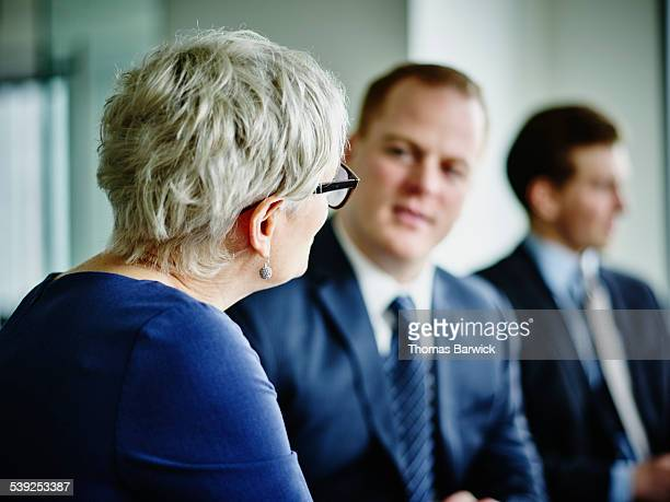 Mature businesswoman leading discussion
