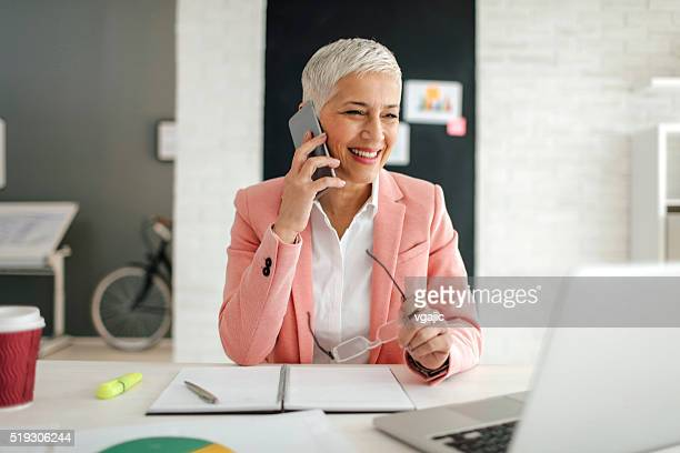 Mature Businesswoman On The Phone In Her Office.