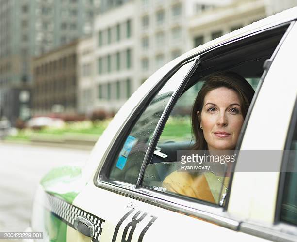 Mature businesswoman  sitting in taxi