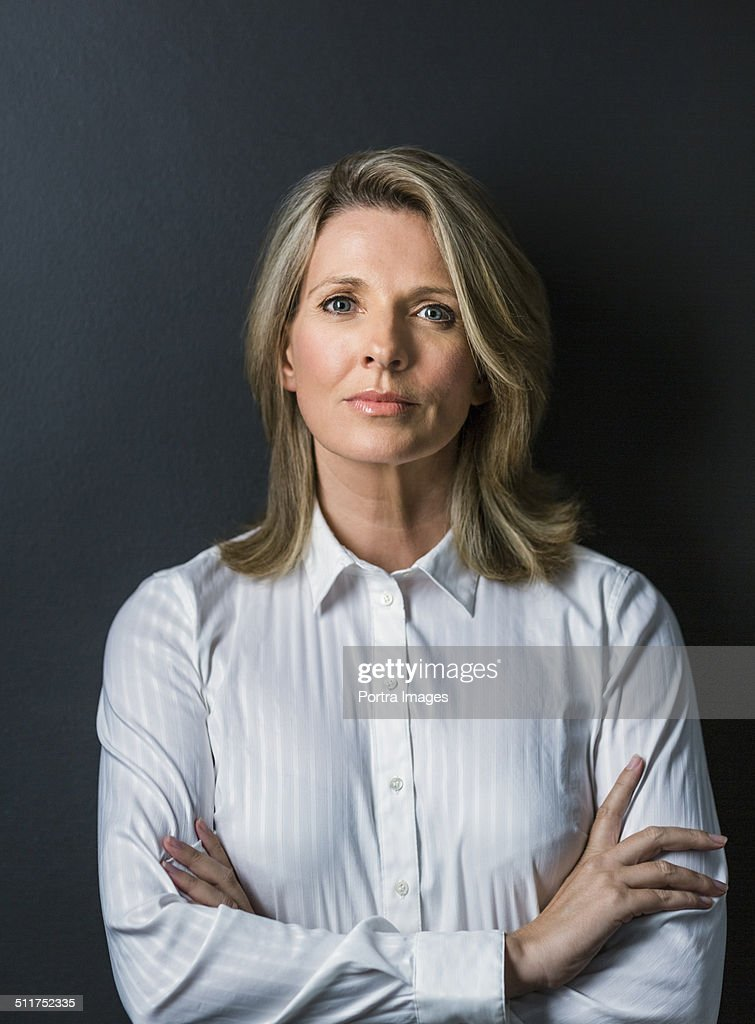 Mature businesswoman standing arms crossed